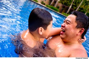 father-son-in-pool