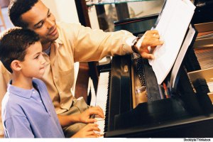 man-and-child-at-piano-with-credits