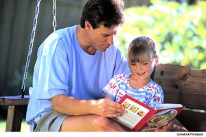 father-reading-to-daughter